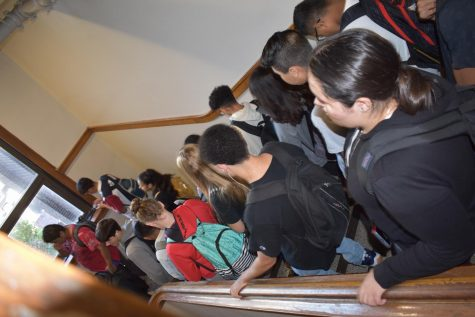 Omaha South High Students going down the side stairs during the passing period to 4th hour. Overcrowding has become a problem at the school.