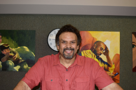 Neal Shusterman smiling for the camera while signing books
