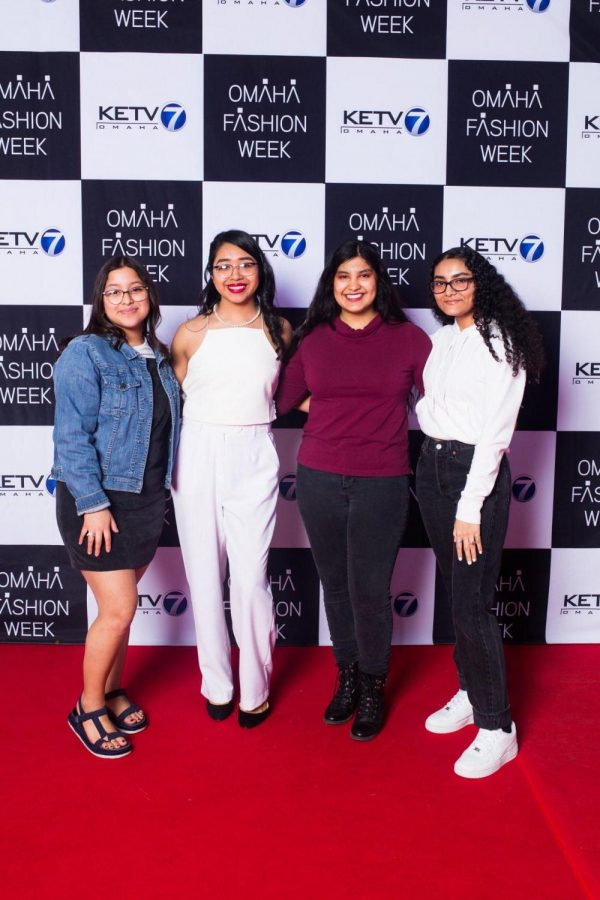 South Alumna and designer Michelle Hernandez poses on the Omaha Fashion Week red carpet.